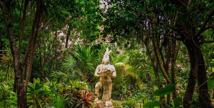 Statue in garden near Cenote Chaak Tun